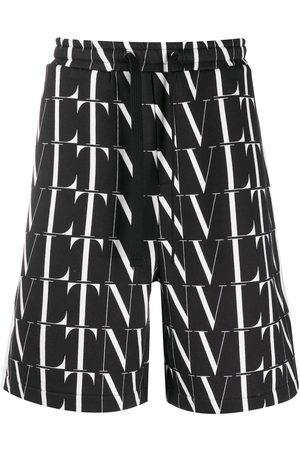 VALENTINO VLTN print Bermuda shorts