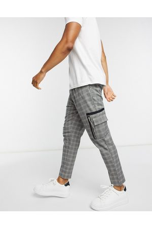 ASOS DESIGN Smart tapered trousers in grey check print and cargo pockets