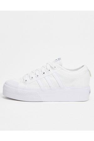 adidas Nizza platform trainers in white