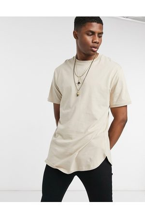 ASOS Relaxed fit longline t shirt with curved hem in beige