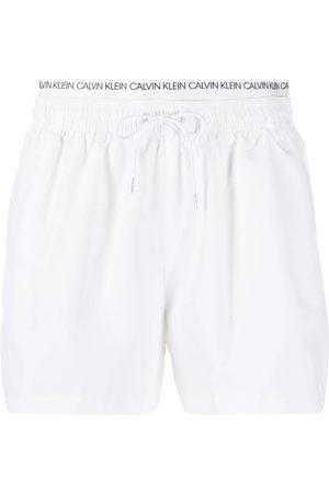 Calvin Klein Muži Šortky - Pánské bílé plavky