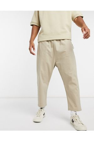 ASOS Drop crotch chino trousers in beige