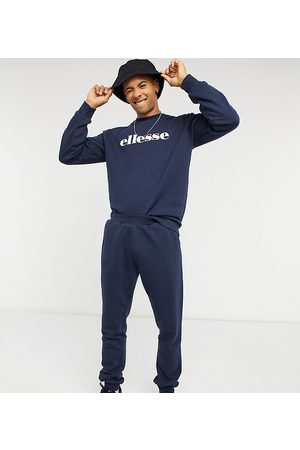 Ellesse Sweatshirt & jogger set in navy exclusive to ASOS