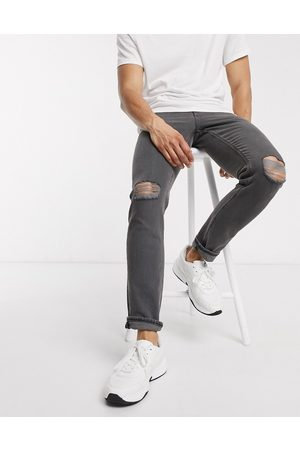 ASOS Stretch slim denim jean in washed black with knee rips