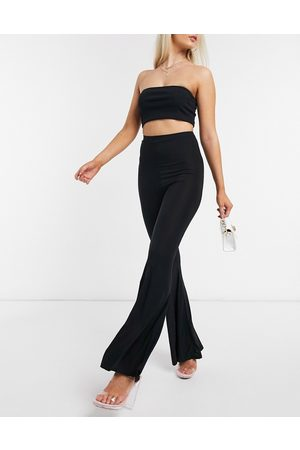 Fashionkilla Flare trouser with ruched bum detail in black