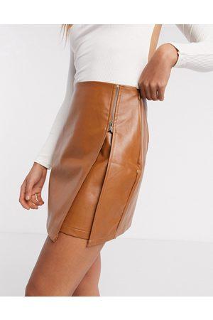 NaaNaa Faux leather zip detail mini skirt in camel-Tan