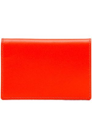 Comme des Garçons Fluorescent orange leather wallet