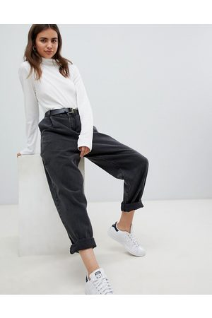 ASOS Tapered boyfriend jeans with curved seams and belt in washed black