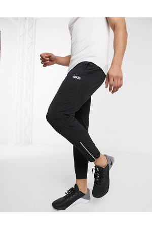 ASOS Icon woven skinny tapered running joggers with reflective zip detail in black
