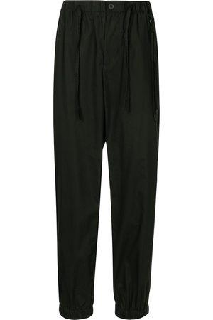 CRAIG GREEN Regular-fit cuffed trousers