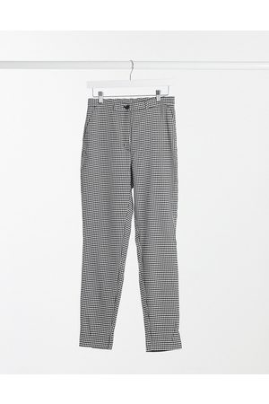 Monki Petra recycled slim trousers in houndstooth-Multi