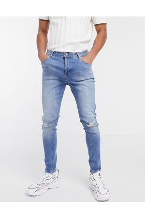 ASOS Muži Skinny - Spray on jeans with power stretch in mid wash blue with rips