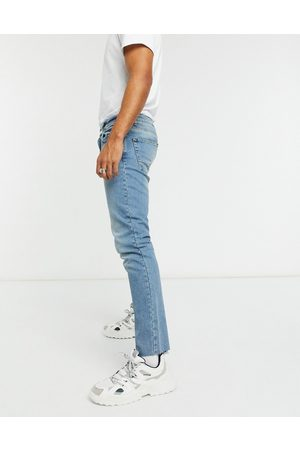 ASOS Slim jeans in tinted mid wash blue with raw hem