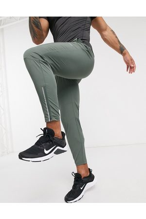 ASOS Muži Kalhoty - Woven skinny tapered running joggers with reflective zip detail in khaki-Green