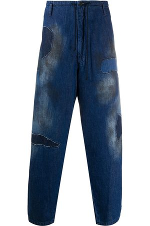 YOHJI YAMAMOTO Stained loose fit jeans