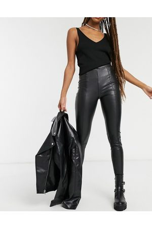 Topshop Faux leather trousers in black