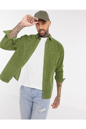 ASOS 90s oversized cord shirt in green