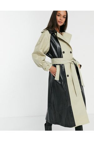 ASOS Spliced vinyl trench coat in stone and black-Beige