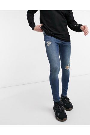 ASOS Spray on jeans with power stretch in vintage dark wash blue with knee rip and abrasions