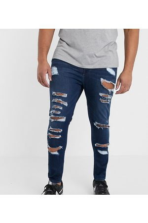 ASOS Plus spray on jeans in power stretch denim in dark wash blue with heavy rips