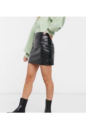 ASOS ASOS DESIGN Petite leather look seamed super mini skirt in black