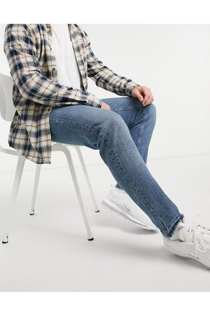ASOS Muži Strečové - Stretch tapered jeans in vintage mid wash with tint-Blue