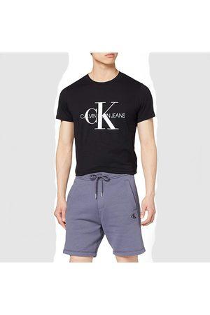 Calvin Klein Muži Šortky - Pánské modré teplákové šortky