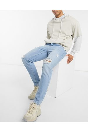 ASOS Slim jeans in light wash blue with heavy rips