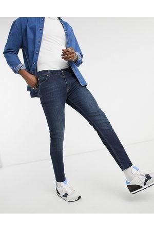 ASOS Skinny jeans in vintage dark wash with raw hem-Blue
