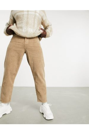 ASOS Muži Džíny - Relaxed tapered corduroy jeans in light brown