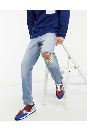 ASOS High rise regular jeans in mid blue 90's wash with knee rip
