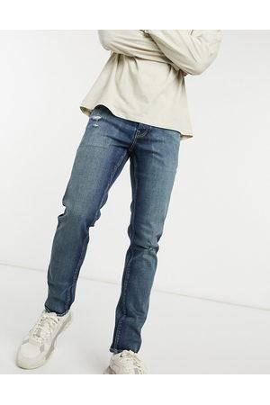 ASOS Stretch slim jean in dark vintage japanese wash with abrasions-Blue