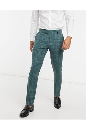 ASOS Wedding skinny suit trousers in pine green crosshatch