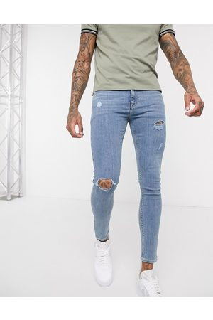 ASOS Muži Skinny - Spray on jeans in power stretch denim in light wash blue with abrasions