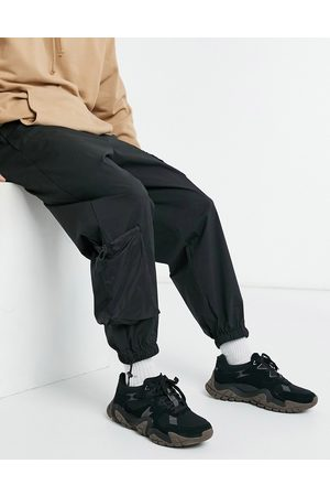 ASOS Muži Tepláky - Joggers with 3D pockets in black