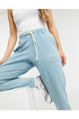 Crooked Tongues Co-ord jogger with peacetimes logo in wash-Multi