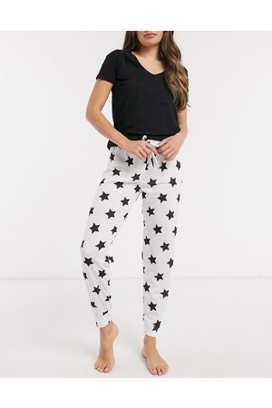 Outrageous Fortune Nightwear skinny jogger in white star print-Multi