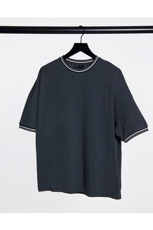 ASOS Oversized pique t-shirt with tipping in washed black
