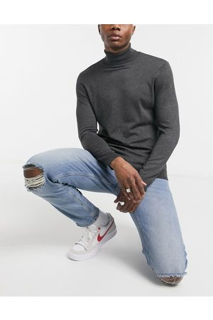 ASOS Stretch tapered jeans in light wash blue with knee rips