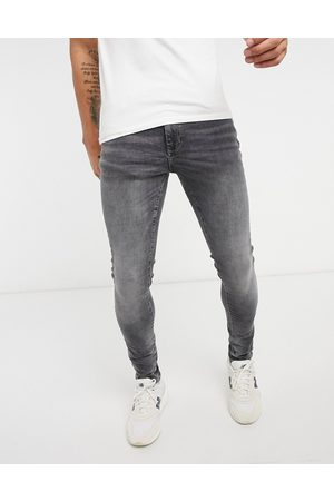 River Island Super skinny jeans in washed black-Stone