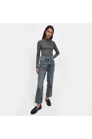 Calvin Klein Ženy Svetry - Dámský černo stříbrný svetr