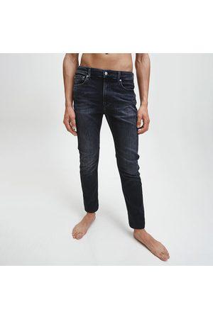 Calvin Klein Pánské tmavě šedé džíny