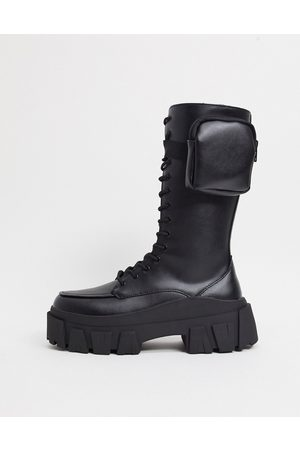 ASOS High lace up calf boots in black faux leather on chunky sole with pocket detail