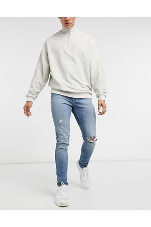 ASOS Skinny jeans in vintage mid wash blue with knee rip and abrasions