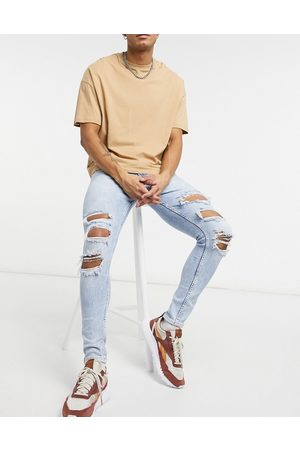Bershka Muži Skinny - Super skinny fit jeans in blue with rips