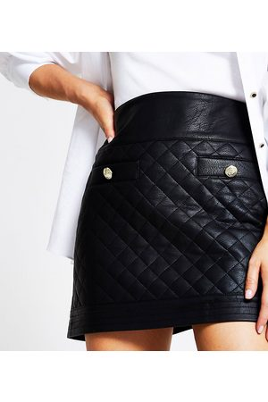 River Island Quilted faux leather mini skirt in black