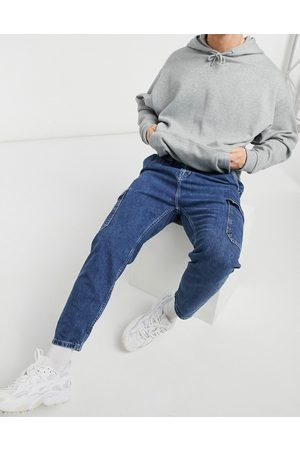 Pull&Bear Carpenter jeans in mid wash blue