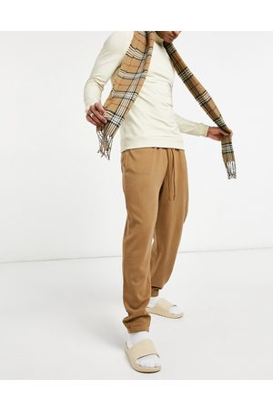 ASOS Oversized joggers with narrow waistband in washed brown