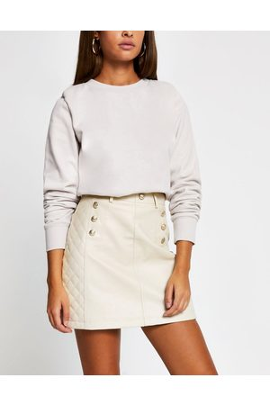 River Island Belted quilted faux leather mini skirt in beige