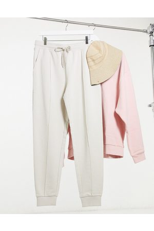 ASOS Muži Tepláky - Tapered joggers with pin tuck in beige